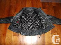 Women's leather motorcycle jacket. Like new, only worn