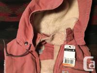 "Medium Womens Carhartt vest in ""dried rose"". Brand new."