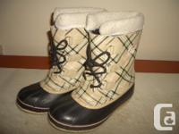 Offering a set of females Sorel winter boots.