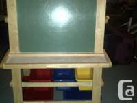 Wood art easel with storage bins. The chalkboard on one