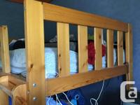 Pine bunk beds with one side rail and drawers. ( I took