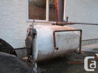 This wood burning hot water stove was used to heat the