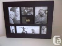 Black wood collage photo frame. Holds 7 pictures. $10.