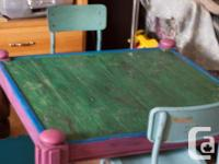 Very nice wood table, it has been painted on top a the