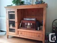"Pine cabinet will certainly fit 32"" flat screen TV,"