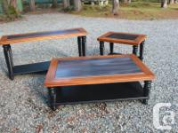 Stylish, well made end table with wooden accents and a