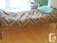 Antique canadian wooden bench. Topped with a futon and