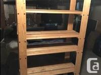 Two identical wooden bookcases or shelves. $25 each or