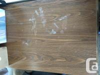 What: Wooden desk with inbuilt drawers on both sides