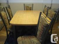 wooden dining table with 6 chairs  in good condition,