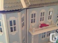 I am selling my beautiful handmade wood doll house.