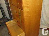 THIS ALL WOOD FOUR DRAWER IS 28 INCHES WIDE, 17 INCHES