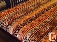 Dark wood framed futon, easy to fold down into a comfy