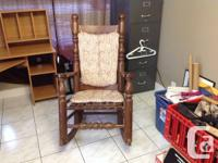 Selling this wooden rocking chair for $25.00 it will