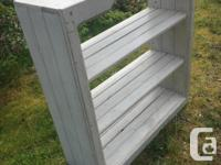 Nice country look shelving unit. Sturdy wood