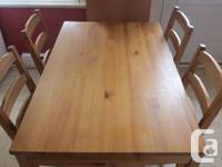Selling our wooden kitchen table, with 4 wooden chairs