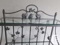This is a gorgeous bakers rack. It is solid wrought