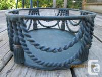 This Green Wrought Iron Decorative Basket Is Adorned