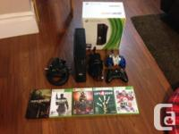 Selling my Xbox 360 4gb slim, comes with 5 games, dark