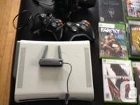 Xbox 360 blanc avec 2 manette noir + Kinect + internet
