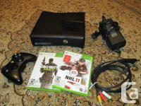 Xbox avec un disc dur de 250gb, une manette sans fils,
