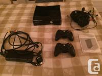 Selling Xbox 360 250GB Slim Console. Comes with two