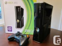 Xbox 360 (Slim) with 2 controllers as well as 250 GB