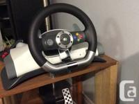 Wired or wireless racing wheel for Xbox 360. Has paddle for sale  British Columbia