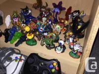 Great Xbox 360 and lots of games and 20 skylanders for