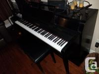 Selling an upright Yamaha piano along with a bench.