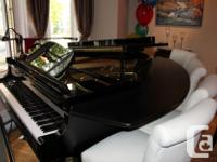 This mint 1996 piano was constructed in Japan. It