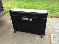 For sale is a Yamaha CP-60m electric upright piano.