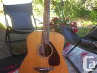 This is a new Yamaha FG 700 series dreadnought that has