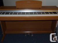 Yamaha full-size electronic piano model YDP-131c,
