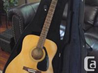 Yamaha F 310 Acoustic Guitar with sturdy guitar case.