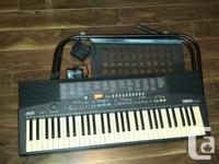 Yamaha Keyboard, 61 key, with pedal and stand. In good