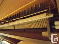 Yamaha upright piano, model M2E. Serial number