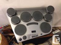 portable, has lots of sample drums and songs, great for