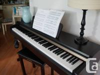 Yamaha YDP-113 Electronic Piano, used but in excellent