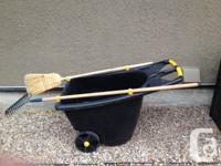 Large, heavy duty, rolling utility yard cart. Has side