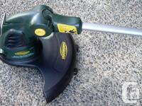 Yardworks electric weed whipper. Adjustable head.