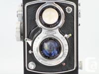Yashica C TLR Runs standard 120 film. 6x6cm images.