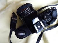 The camera is in well used condition with worn leather