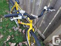 Medium-Large yellow mountain bike for sale. Painted