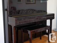 This beautiful piano made in Korea by YOUNG CHANG is in