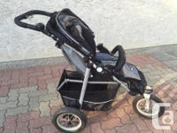 3 wheel jogger in black and silver in color, comes with